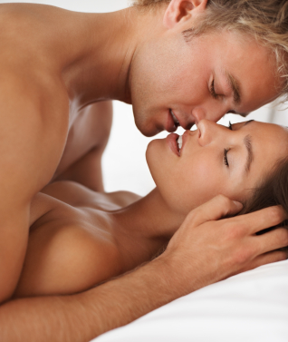 Intimate couple during sexual intercourse on the bed